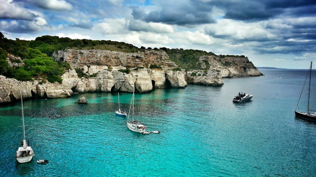 Menorca coast scene with boats.