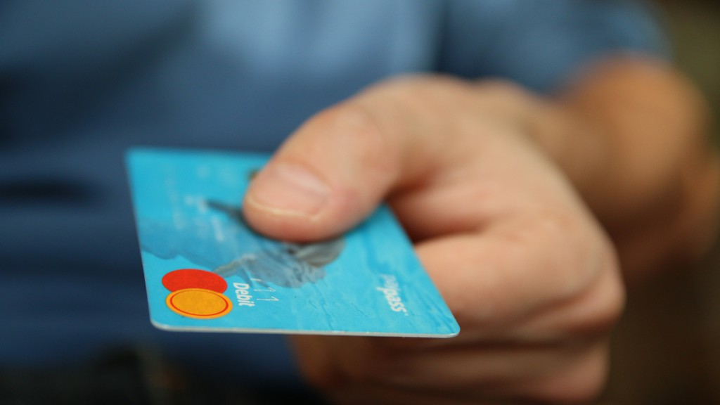 Man handing over a debit card in exchange for foreign currency at MoneyCorp